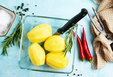 Raw potato prepare for cooking, Fresh organic golden potatoes. 写真素材