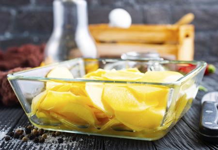 raw potato in glass bowl, potato for baking