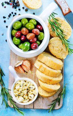 olives and fresh bread on a table