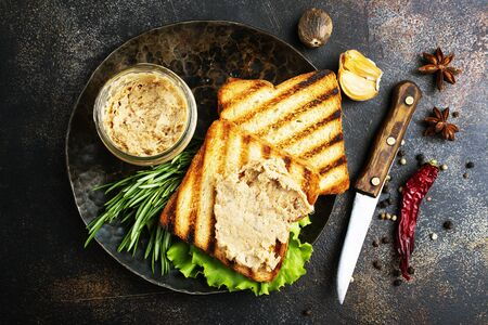 bread with liver pate on plate, delicious poultry liver pate Stock Photo - 127281193