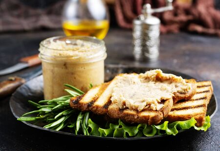 bread with liver pate on plate, delicious poultry liver pate Stock Photo - 127281237