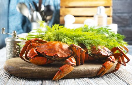 Cooked crab on wooden board Seafood boiled red stone crab with spices Stock Photo
