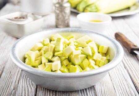 green zucchini on dark background. Healthy food, green vegan diet. Stok Fotoğraf