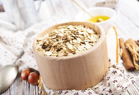 oat flakes with nuts and raisin, oat flakes in wooden bowl