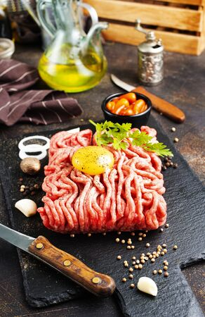 Raw minced meat with egg, herbs and spices