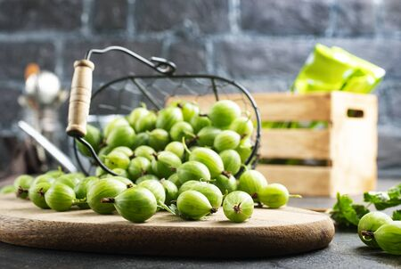 fresh gooseberry, gooseberry in metal basket on a table Archivio Fotografico