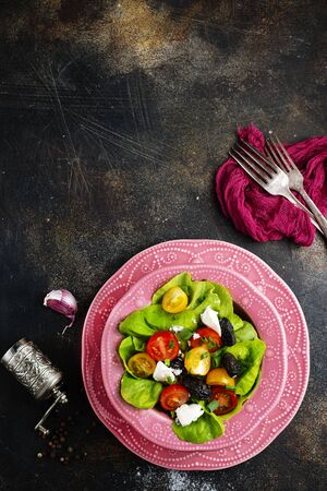 salad with tomato cheese and black olives