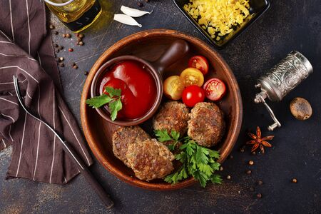 fried cutlets with tomato sauce and fresh tomato