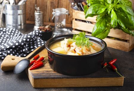 Chicken and potato  soup with lentil and carrot in bowl