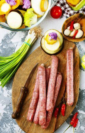 raw sausages with aroma spice on wooden board Zdjęcie Seryjne