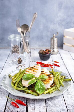 chicken breast grilled with green beans and spice Reklamní fotografie
