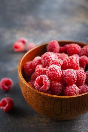 fresh berries, Fresh raspberry in wooden bowl Reklamní fotografie