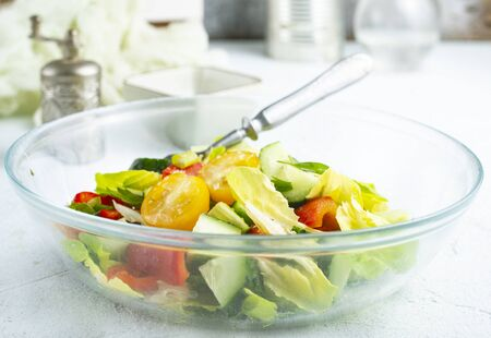 salad with fresh tomato and cucumbers in bowl Stockfoto