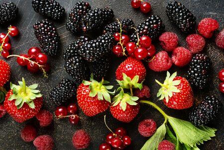 Background of fresh fruits and berries. Ripe blackberries