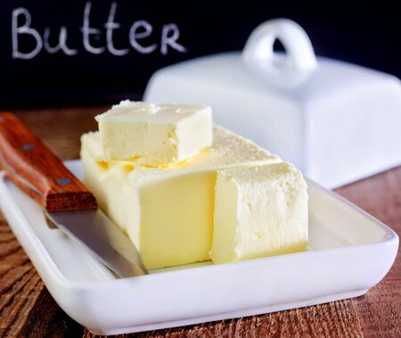 butter on white plate and on a table