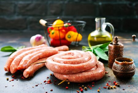 raw sausages with spice on a table Stockfoto
