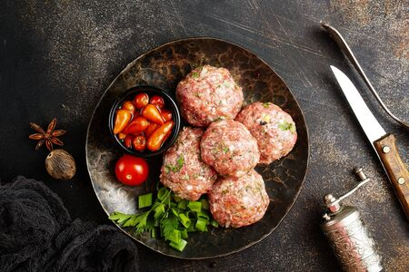 raw cutlets with salt and spice, minced meat on plate