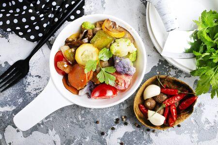 baked vegetables in white bowl, diet food Banco de Imagens