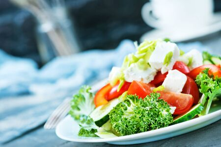 fresh salad with feta cheese on the plare Stockfoto