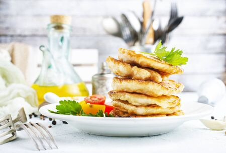fried chicken cutlets on white plate on a table Banco de Imagens