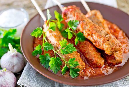 Ljulja-kebab with tomato sauce on the plate 版權商用圖片
