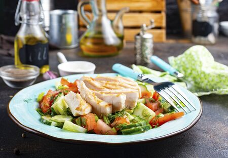 baked chicken with fresh vegetables, chicken with salad