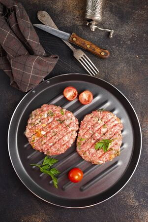 raw ninced meat with salt and spice
