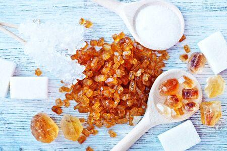different kind of sugar on the white table Reklamní fotografie