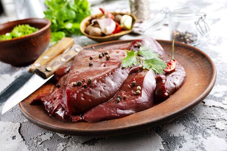 raw liver on plate on a table