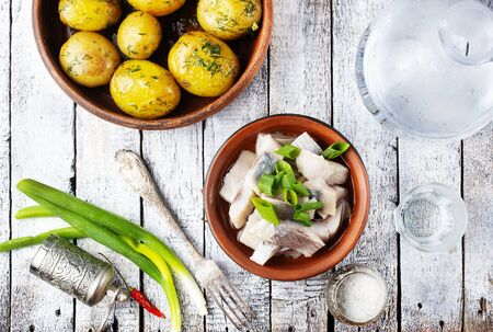 Russian traditional cuisine: salted herring with boiled potatoes