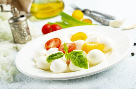 mozzarella with fresh tomato on white plate Stock Photo