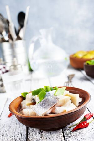 Russian traditional cuisine: salted herring with boiled potatoes Stockfoto