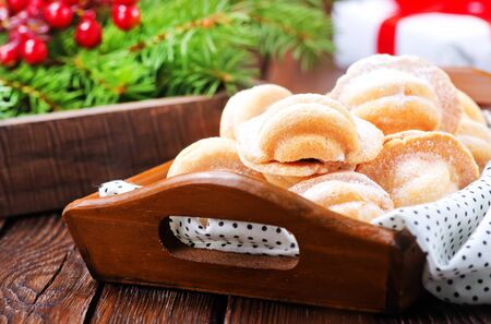 christmas cookies with creame on the wooden tray