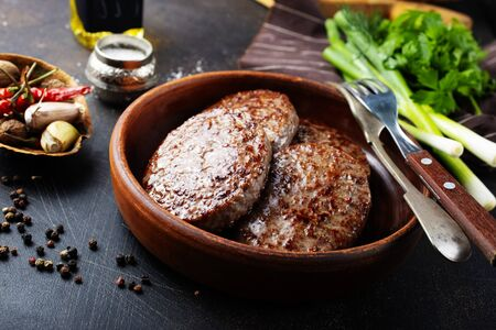 fried meat cutlet for burger in brown bowl Stock Photo