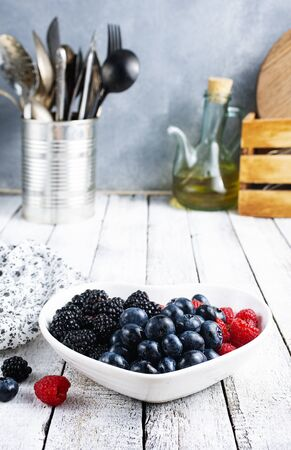 fresh  berries in white bowl on  a table