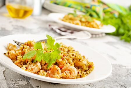 fried bulgur with shrimps  on white plate