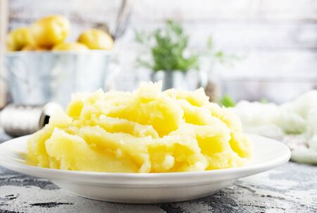 mashed potato with butter in white bowl