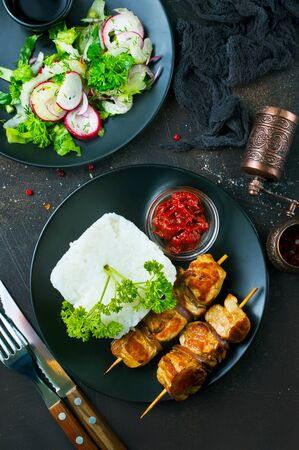 kebab with boiled rice on plate, stock photo