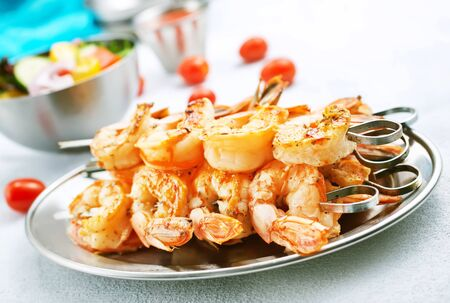 fried shrimps with spice, shrimps on plate, stock photo