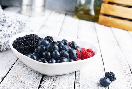 fresh mix berries in white bowl on  a table