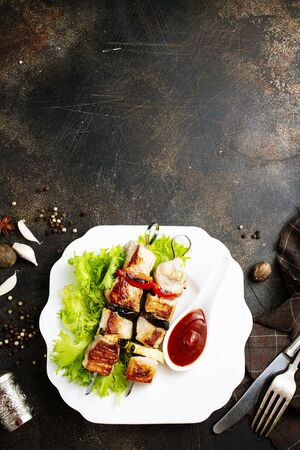 meat kebab with salad leaf and ketchup
