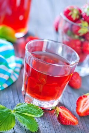 strawberry drink in cup and on a table Фото со стока