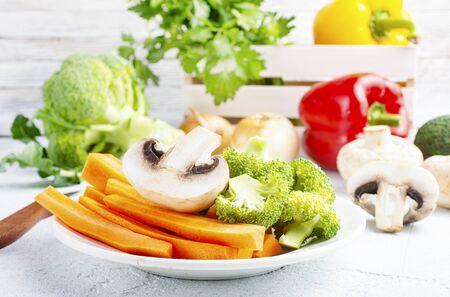 raw vegetable fresh greens and mushrooms on a table Фото со стока - 136585870