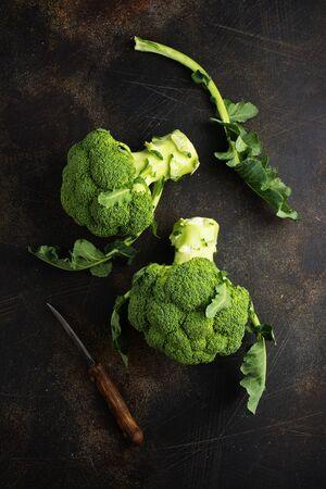raw broccoli, fresh broccoli on wooden board
