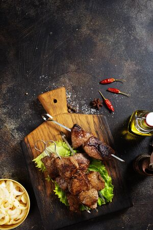 meat kebab with salad on wooden board Stock Photo