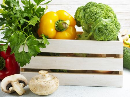 Raw vegetables on a table. Fresh pepper broccoli and other vegetables