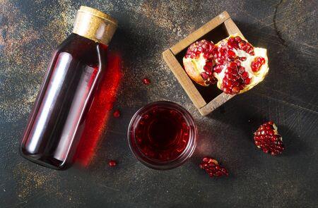 pomegranate juice in bottle, fresh juice and pomegranate