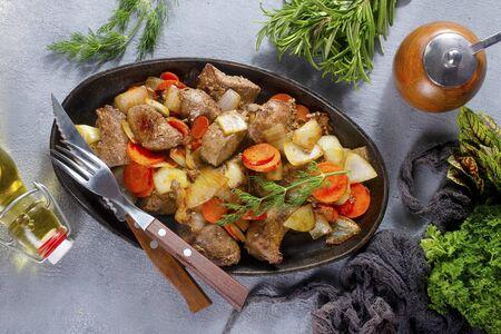 fried potato with liver on metal plate 版權商用圖片