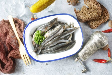 anchovy with salt and cold vodka on a table