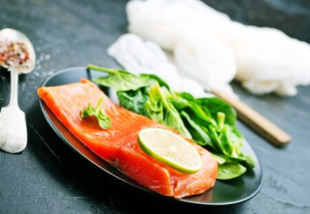 salmon with lemon and fresh spinach, diet food